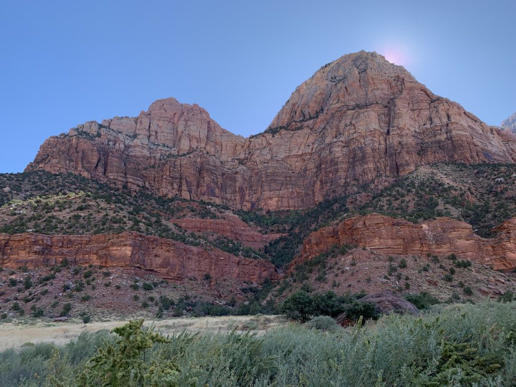 Sun behind Red Rocks Utah